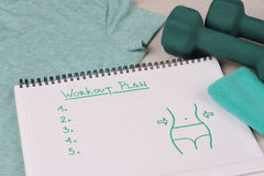 Female Workout plan, dumbbells and spot t shirt . Woman weight loss, body toning concept. Fitness motivation, sport, challenge bac Stock Photography