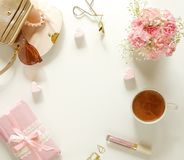 Female workplace with flowers, gift,, cup of cocoa, make up accessories stock photography