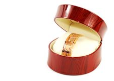 Female wrist watch for gift. Woman fastion watch in wooden box ,over white stock photography