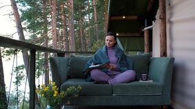 Female Writer Working on Essay while Glamping