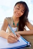 Female writing on a notebook Royalty Free Stock Images