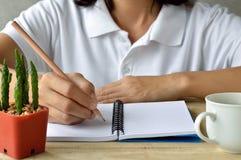 Female writing on notebook Stock Photos