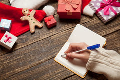 Female writing wish list Stock Images