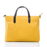 Female yellow leather handbag Royalty Free Stock Images