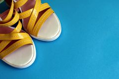 Female yellow sandals stand in a corner of the photo stock photography