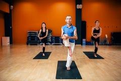 Female yoga group, training with instructor Royalty Free Stock Photography