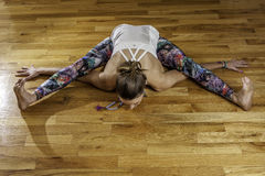 Female Yoga Model Kurmasana Tortoise Pose Overhead Stock Photos