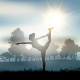 Female in yoga pose in countryside Royalty Free Stock Photo