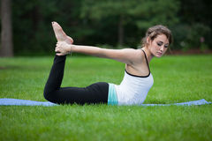Female Yoga Practice  at Outdoor Park Stock Image
