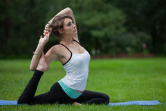 Female Yoga Practice  at Outdoor Park Royalty Free Stock Image