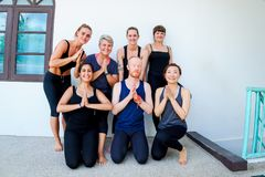 Female yoga students and their yoga teacher. Doing a group photo together. Different people and different emotions Royalty Free Stock Photo