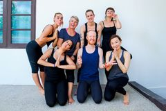 Female yoga students and their yoga teacher. Doing a group photo together. Different people and different emotions Stock Photography
