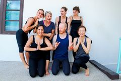 Female yoga students and their yoga teacher. Doing a group photo together. Different people and different emotions Royalty Free Stock Image