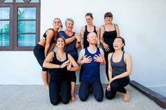 Female yoga students and their yoga teacher. Doing a group photo together. Different people and different emotions Stock Photo