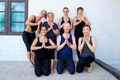 Female yoga students and their yoga teacher. Doing a group photo together. Different people and different emotions. Peaceful Royalty Free Stock Photo