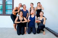 Female yoga students and their yoga teacher. Doing a group photo together. Different people and different emotions. Funny Stock Photos