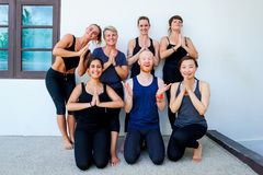 Female yoga students and their yoga teacher. Doing a group photo together. Different people and different emotions. Smiling Stock Photography