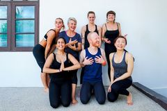 Female yoga students and their yoga teacher. Doing a group photo together. Different people and different emotions. Smiling, happy time Stock Photography