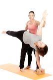 Female yoga teacher provides assistance Royalty Free Stock Photography