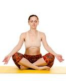 Female yogi practising yoga exercises Royalty Free Stock Photos