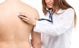 Female young doctor holding patient's lung auscultation with blu. E phonendoscope Royalty Free Stock Image
