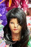 Female young looking mannequin head wearing a wig royalty free stock images