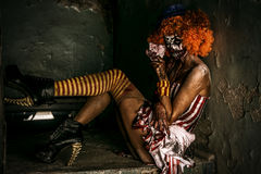 Female zombie clown. Bloody scary clown. Halloween. Horror royalty free stock photography