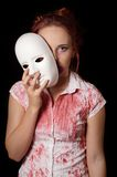 Female zombie with halloween mask Royalty Free Stock Photography
