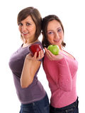 Females with apples Stock Photography