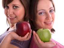Females with apples Royalty Free Stock Image