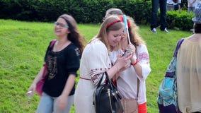 Females with camera, Embroidery dress Vyshyvanka parade in Kiev, Ukraine, stock video