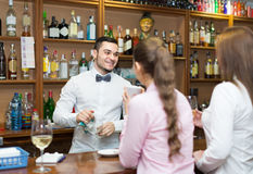 Females  chatting and drinking wine in bar Royalty Free Stock Image