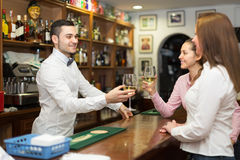 Females  chatting and drinking wine in bar Stock Images