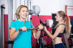Females of different age strength training in gym royalty free stock photos