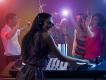 Females dj spinning records at party Royalty Free Stock Image