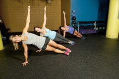Females Doing A Modified Side Plank Royalty Free Stock Photos