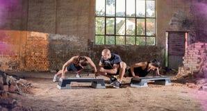 Females doing push-ups Stock Image