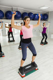 Females Doing Step Aerobics In Gym Royalty Free Stock Images