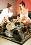 Females fireplace gossip Royalty Free Stock Photo