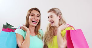 Females friends with shopping bags. On white screen stock footage