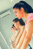 Females In Gym Stretching Royalty Free Stock Photo