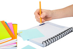 Females hand writing in notebook. On isolated white background Stock Photo