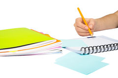 Females hand writing in notebook. On isolated white background, closeup Stock Photo