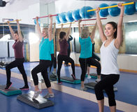 Females having gymnastic class in gym Stock Image