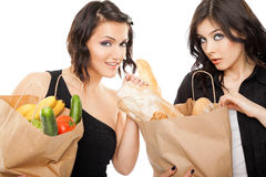 Females holding shooping bags groceries Royalty Free Stock Photos