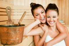 Females hugging sauna Royalty Free Stock Photography
