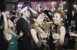 Females and males celebrating new year Royalty Free Stock Photos