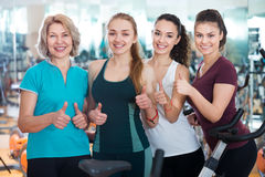 Females in modern fitness club. Portrait of positive females at modern fitness club Royalty Free Stock Images