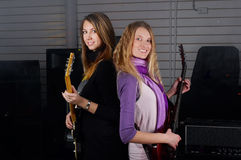 Females play on rock guitar Royalty Free Stock Photo