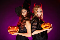 Females with pumpkins Stock Image